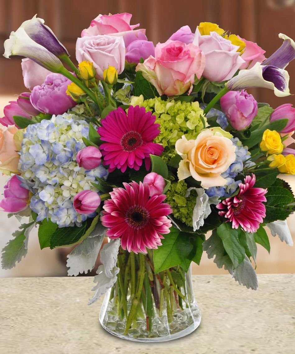 Best long beach florist allens flower market long beach page 9 european spring flowers are at the center of this flower arrangement and include peony gerbera daisies tulips roses hydrangea statice blueplurum izmirmasajfo